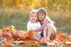 Portrait of two girls in the woods Royalty Free Stock Image