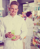 Portrait of two glad adult pharmacists Stock Photo