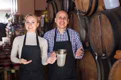 Portrait of two glad wine makers taking wine Stock Photos