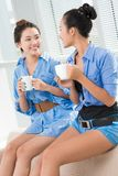 Did you hear about it?. Portrait of two gossip girls indoors Stock Image