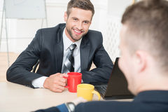 Portrait of two handsome businessmen in suits Royalty Free Stock Photo
