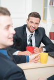 Portrait of two handsome businessmen in suits Stock Photography