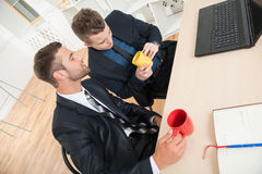 Portrait of two handsome businessmen in suits Stock Images