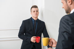 Portrait of two handsome businessmen in suits Royalty Free Stock Images