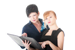 Portrait of two handsome women holding folder with papers. Stock Image