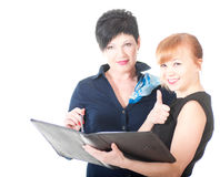 Portrait of two handsome women holding folder with papers. Royalty Free Stock Images
