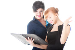 Portrait of two handsome women holding folder with papers. Stock Images