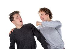 Portrait of two handsome and young furious men fighting with each other on white background royalty free stock photos