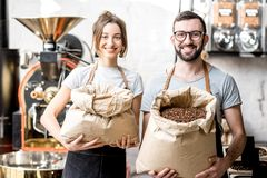 Portrait of baristas with coffee beans Royalty Free Stock Photos