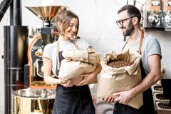 Portrait of baristas with coffee beans Stock Image