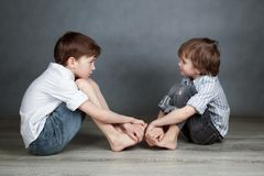 Portrait of two happy brothers on agray background Royalty Free Stock Photography