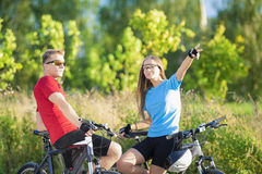 Portrait of Two Happy Caucasian Bikers Resting in the Forest Royalty Free Stock Image