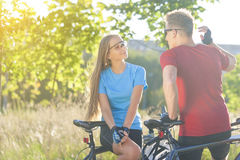 Portrait of Two Happy Caucasian Bikers Resting in the Forest Stock Image