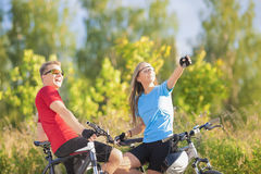 Portrait of Two Happy Caucasian Bikers Resting in the Forest Stock Images
