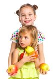 Portrait of two happy girls with apple. S isolated on white background Royalty Free Stock Photography