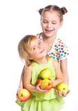 Portrait of two happy girls with apple. S isolated on white background Stock Photo