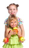 Portrait of two happy girls with apple. S isolated on white background Royalty Free Stock Image
