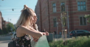 Two young girls in a city enjoying summer. stock footage