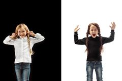 Portrait of two happy girls on a white and black background royalty free stock photos