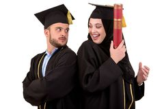 Portrait of two happy graduating arabic muslim students. Isolated over white background. Portrait of two happy graduating arabic muslim students. Isolated over Royalty Free Stock Images