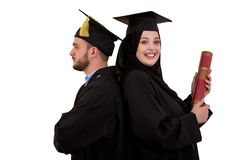 Portrait of two happy graduating arabic muslim students. Isolated over white background. Portrait of two happy graduating arabic muslim students. Isolated over Royalty Free Stock Photography