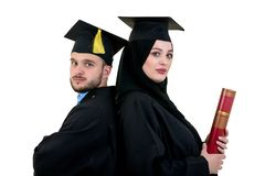 Portrait of two happy graduating arabic muslim students. Isolated over white background. Portrait of two happy graduating arabic muslim students. Isolated over Royalty Free Stock Image
