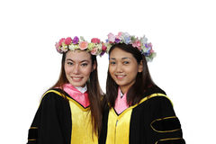 Portrait of two happy graduating students Royalty Free Stock Photo