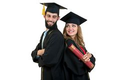 Portrait of two happy graduating students. Isolated over white background. Portrait of two happy graduating students. Isolated over white background Stock Images