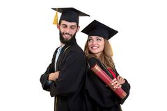 Portrait of two happy graduating students. Isolated over white background. Portrait of two happy graduating students. Isolated over white background Royalty Free Stock Photography