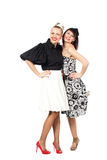 Portrait of two happy, laughing girls. Looking against each other on a white background Stock Photos
