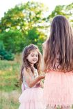 Portrait of Two Happy little girls having fun and embracing at. Portrait of Two Cute little girls having fun and embracing at sunny summer day Royalty Free Stock Images