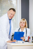 Portrait of two happy mature doctors. Royalty Free Stock Images