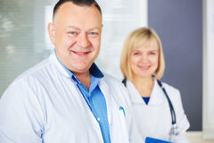 Portrait of two happy mature doctors. Stock Images