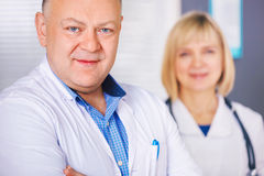 Portrait of two happy mature doctors. Royalty Free Stock Photos