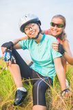 Portrait of two happy positive looking female sport athletes hav. Ing fun together outdoors.vertical image Royalty Free Stock Photography