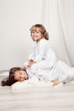 Portrait of two happy sisters, christmas Stock Photos