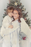 Portrait of two happy sisters, christmas Stock Photo