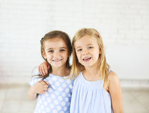 Portrait of two happy smiling young girls Royalty Free Stock Images