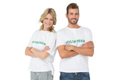 Portrait of two happy volunteers with hands crossed Royalty Free Stock Photography