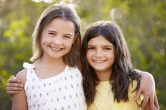 Portrait of two happy young girls embracing outdoors Stock Image