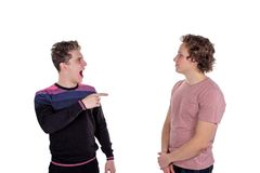 Portrait of a two happy young men pointing fingers isolated over white background royalty free stock photos