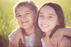 Portrait of two hispanic teen girls. Portrait of two hispanic teens girls resting on meadow Royalty Free Stock Photography