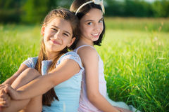 Portrait of two hispanic teen girls. Portrait of two hispanic teens girls resting on meadow Royalty Free Stock Image