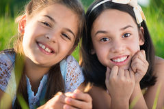 Portrait of two hispanic teen girls. Portrait of two hispanic teens girls resting on meadow Stock Photography