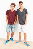 Portrait Of Two Hispanic Teenage Boys Leaning Against Wall Stock Images