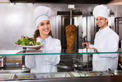 Portrait of two hospitable chefs with kebab Royalty Free Stock Images