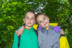 Portrait two hugging boys, tweens. Portrait of two hugging boys, tweens Royalty Free Stock Image