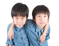 Portrait of two hugging boys, twins. Portrait of two hugging boys, asian twins isolated on white background Stock Photography