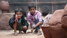 Portrait of two Indian boys pointing a laser gun. MUMBAI, INDIA - 12 JANUARY 2015: Portrait of Indian boy pointing a laser gun, blurred stock video footage