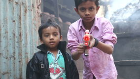 Portrait of two Indian boys pointing a laser gun. stock footage